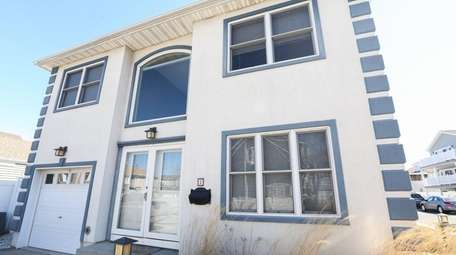 This four-bedroom canal-front house in Long Beach is