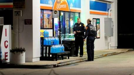 Suffolk County police investigate a robbery at the