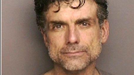 David W. Liss, 47, of Ridge, was arrested