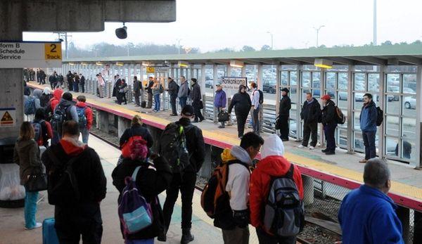 LIRR commuters await a train at the Ronkonkoma