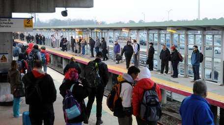 LIRR commuters await a train at the Ronkonkoma