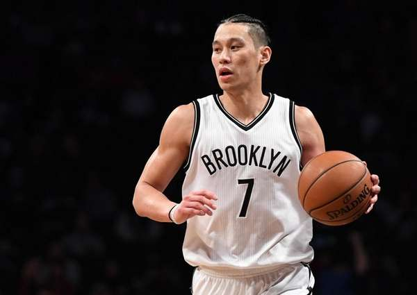 Nets guard Jeremy Lin controls the ball against