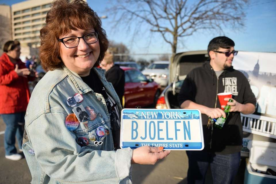 Maureen Smith, of Lynbrook, holds her Billy Joel