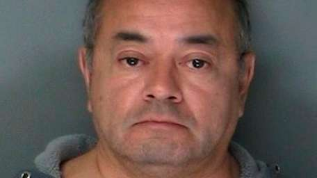 Cesar Gonzales-Mugaburu, 60, of Ridge, is charged with