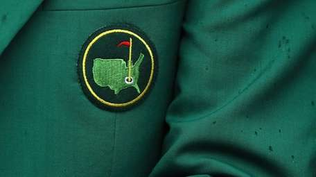 A detail of a green jacket is seen