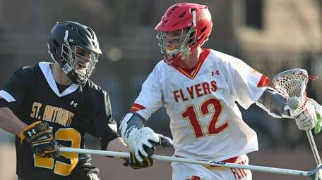 Matthew Chmil #12 of Chaminade, right, gets pressured