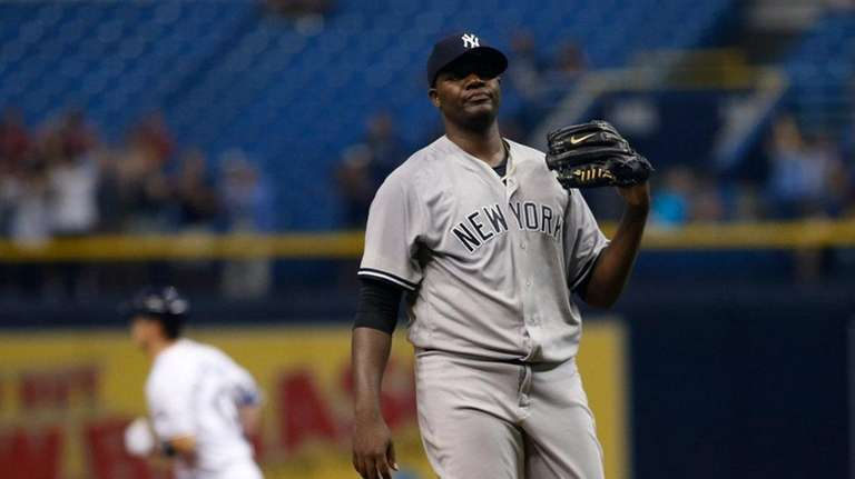 Yankees' Michael Pineda reacts after allowing a home