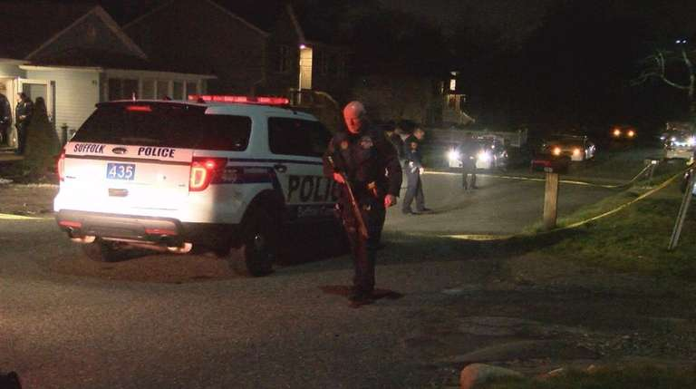 Suffolk County police officers respond to a home