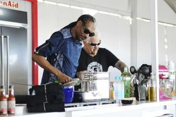 Snoop Dog, left, and Chef Guy Fieri cooking