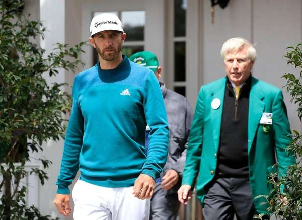 Dustin Johnson walks out of the clubhouse after