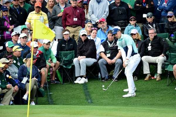 Jordan Spieth of the United States chips onto