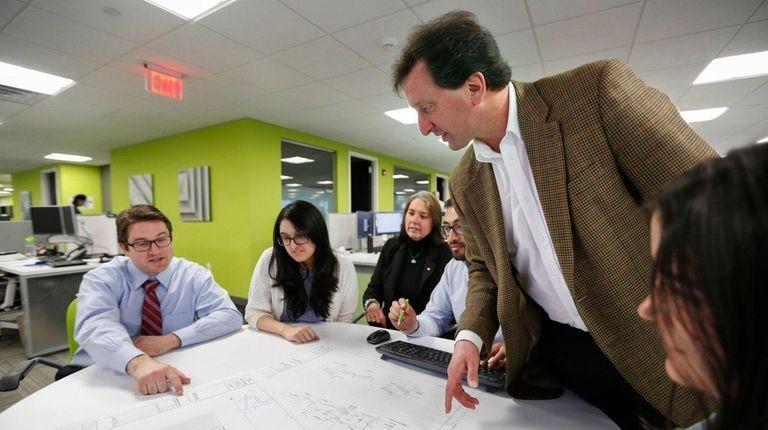 Richard W. Humann, standing, president of H2M Architects