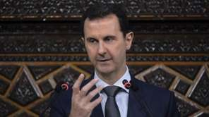 Syrian President Bashar Assad, addresses the newly-elected parliament