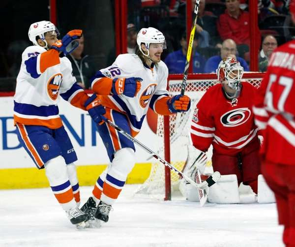 New York Islanders' Scott Mayfield (42) celebrates his