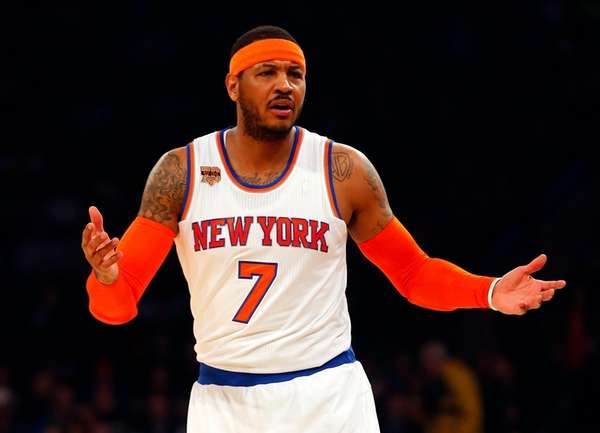 Knicks forward Carmelo Anthony reacts in the first