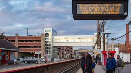 Commuters wait for a Long Island Rail Road
