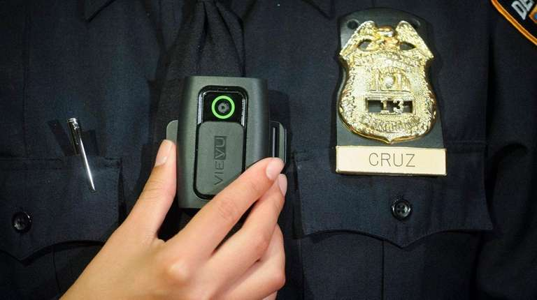 New York Police Department Sgt. Andrea Cruz wears