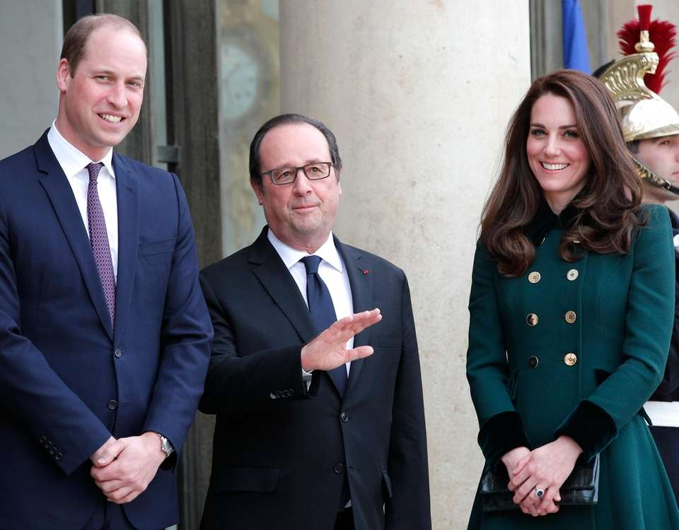 French President Francois Hollande, center, welcomes Prince William