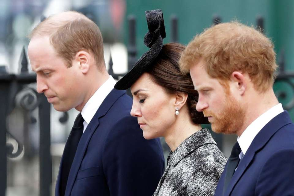Prince William, left, Kate and Prince Harry stand