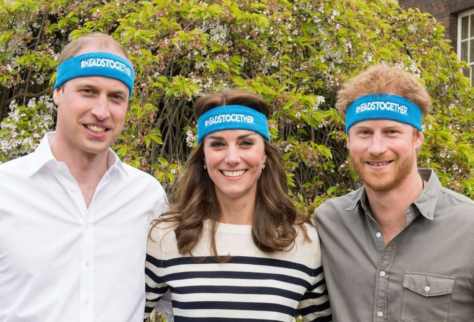 Prince William, left, Kate and Prince Harry pose