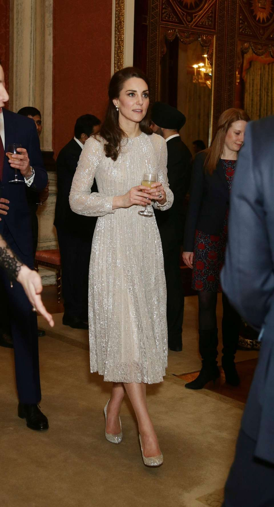 Duchess Kate, Duchess of Cambridge, enters a reception
