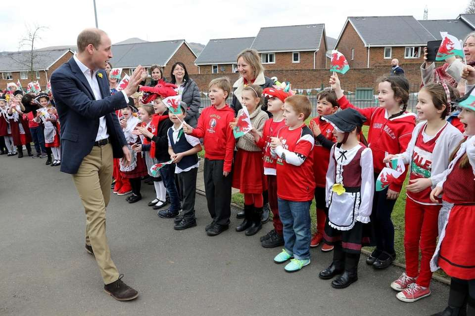Prince William greets children as he launches the