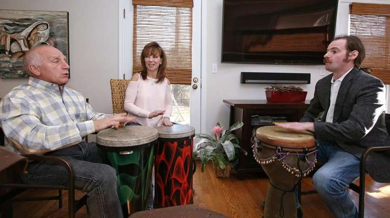 Music therapist Noah Plotkin leads a drumming and