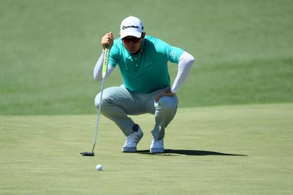 Justin Rose lines up a putt on the
