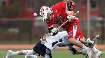 Michael Carere, #13, of Connetquot and Cole Pillion,