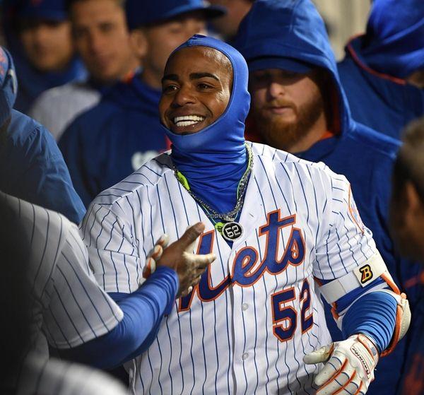 New York Mets leftfielder Yoenis Cespedes is greeted