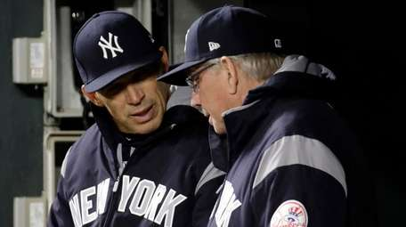 New York Yankees manager Joe Girardi, left, speaks