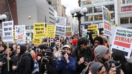 Several hundred people demonstrate Friday, April 7, 2017,