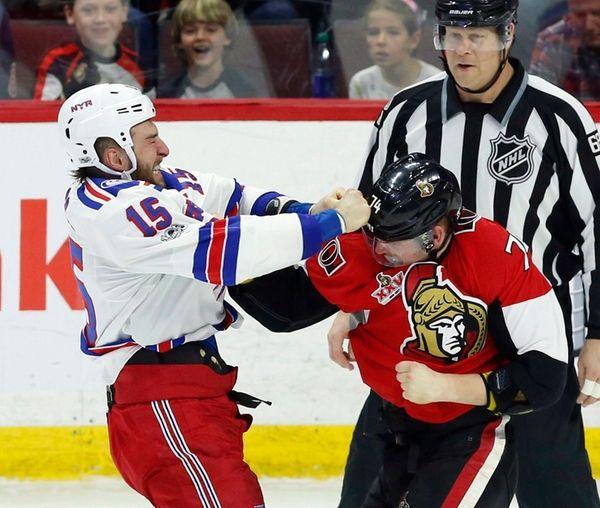 Ottawa Senators' Mark Borowiecki (74) fights with New