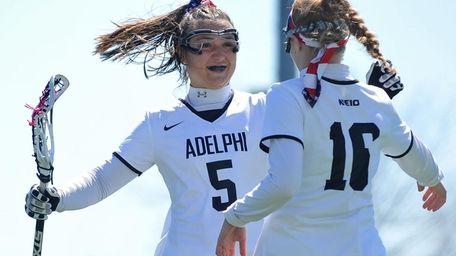 Jacqueline Jahelka, #5, of Adelphi congratulates teammate Alison