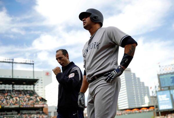 New York Yankees' Gary Sanchez walks off the
