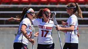 Stony Brook's Kylie Ohlmiller #17 is congratulated by