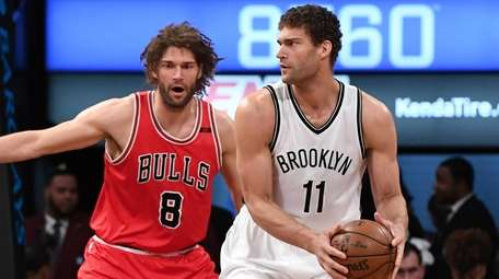 Brooklyn Nets center Brook Lopez is defended by