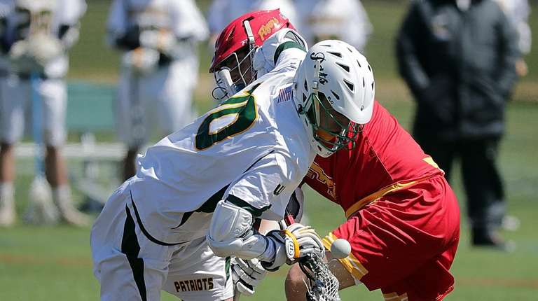 Ward Melville's Brandon Aviles (10) comes up with