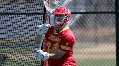 Chaminade's goalie Andrew Bonafede (34) comes up with