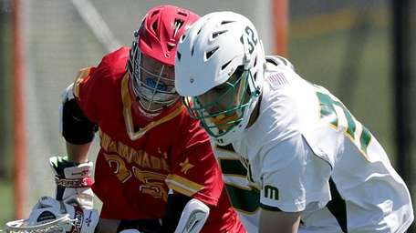 Ward Melville's Alex Mazzone scoops up the loose