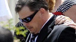 Daniel Schuler, whose wife, Diane, and daughter, Erin,