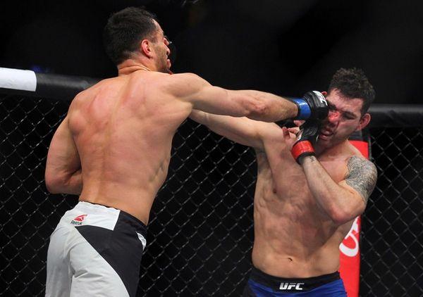 Gerard Mousasi, left, hits Chris Weidman during a