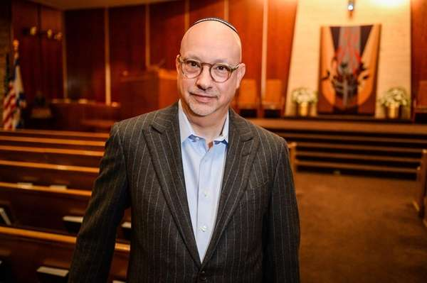 Rabbi Michael White stands inside the sanctuary at