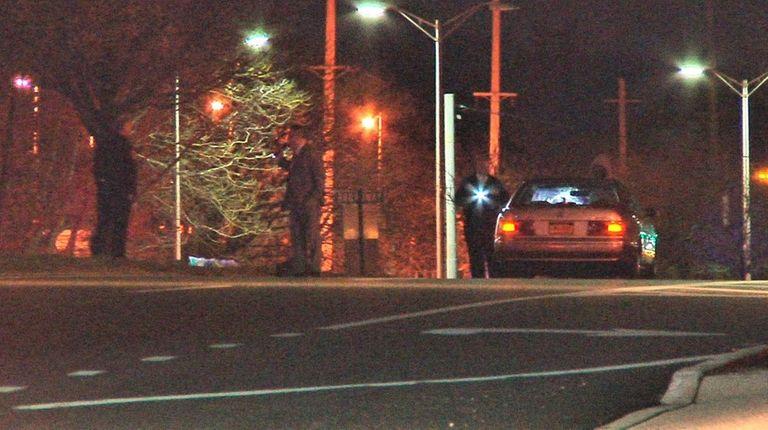 Investigators at the scene where Suffolk police said