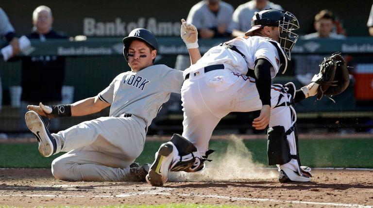 New York Yankees' Jacoby Ellsbury, left, slides past