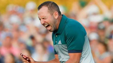 Sergio Garcia, of Spain, reacts after making his