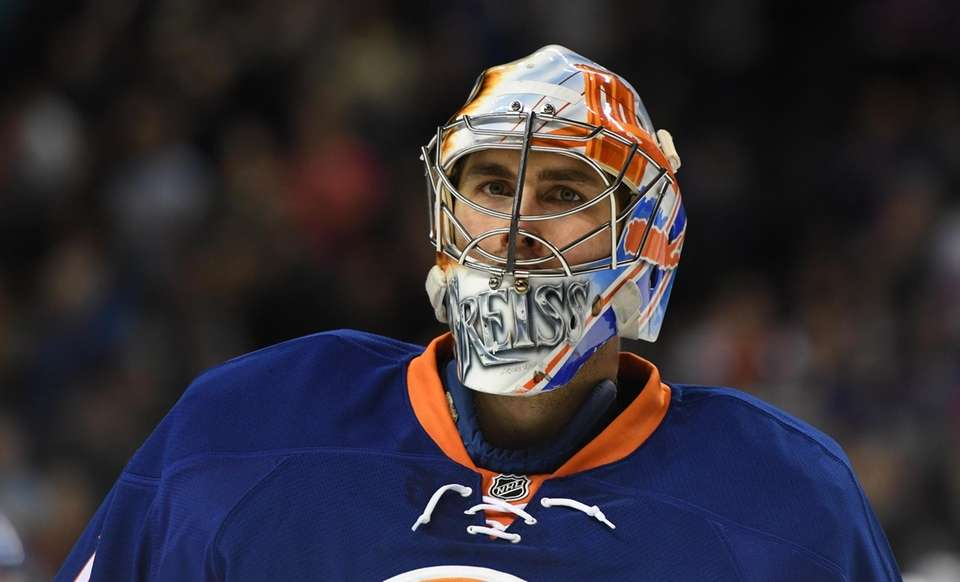 New York Islanders goalie Thomas Greiss looks on