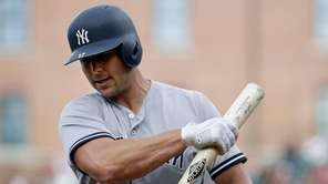 New York Yankees' Matt Holliday reacts after striking