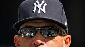 Yankee Stadium is reflected in the sunglasses of