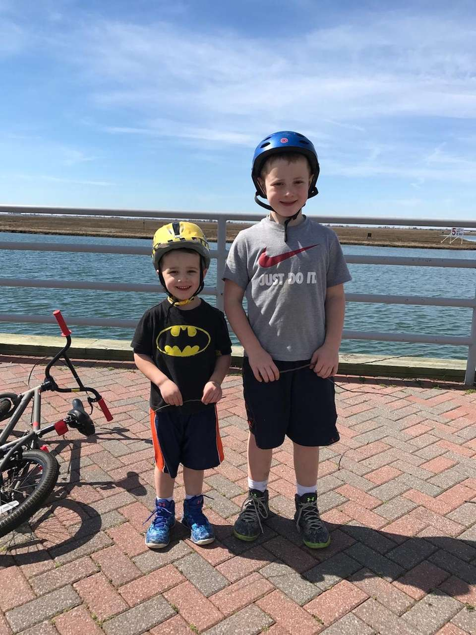 Jack and Joseph riding bikes at Seamans Neck